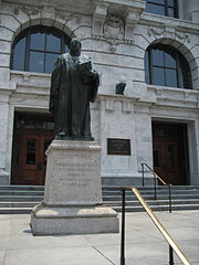 French Quarter, New Orleans: Front of courthouse building on Royal Street. Statue is of Supreme Court Justice White. Photo by Infrogmation